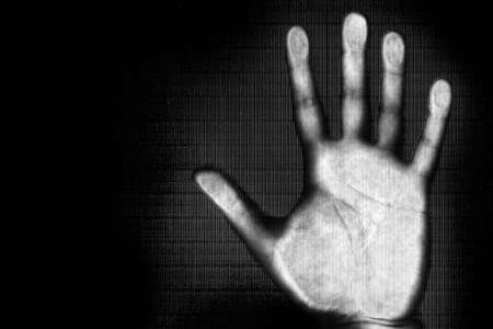 Scan from man hand in black and white - internet and futuristic concepts Stock Photo - 1423914