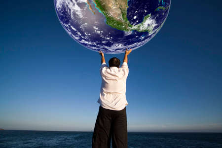 enviroment: Man with white shirt holding the planet earth - science and enviroment concept