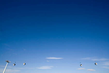 Blue sky minimalistic view of cablecars in Lisbon photo