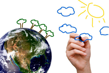 top of the world: child drawing a better world on top of the earth globe Stock Photo