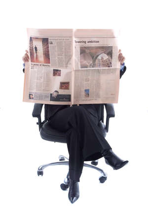 Businesswoman reading the daily newspaper isolated in white background
