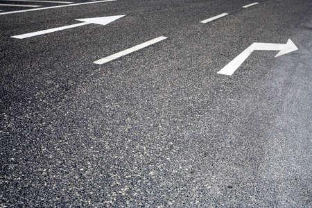 traffic signs painted in asphalt