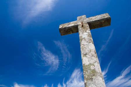 almighty: Big stone cross in blue sky