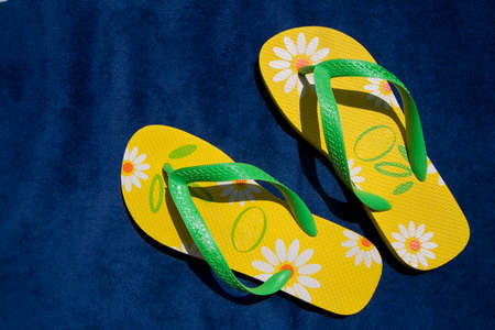 flipflops: green and yellow flip-flops - summer and beach concepts Stock Photo