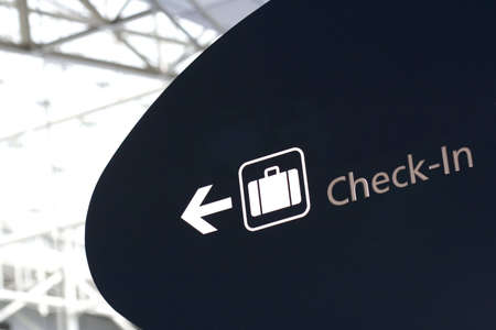 businesstrip: Check-in sign in international airport - blown highlights for more impact Stock Photo
