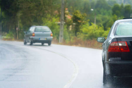 Driving in the rain with wet roads