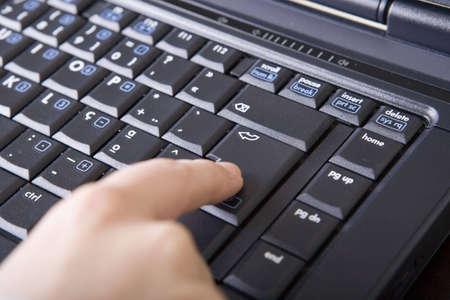 Woman hand touching laptop computer keyboard Stock Photo - 2988881