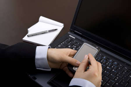 businesswoman using modern pda in office photo