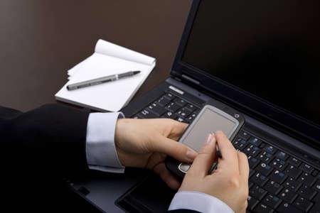 businesswoman using modern pda in office