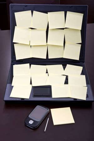 laptop computer full of blank post-it reminders