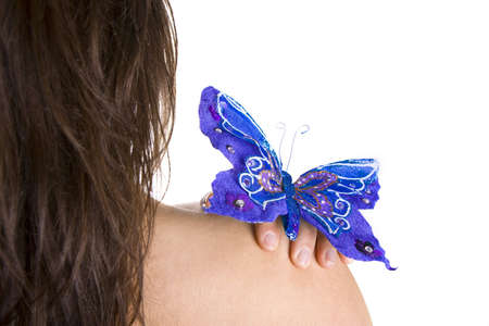 blue butterfly resting on woman naked shoulder