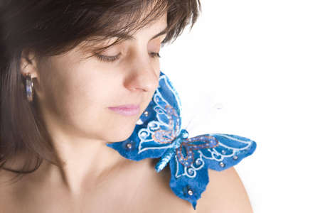 beautiful young woman with blue butterfly in her naked shoulder - focus on the eye photo