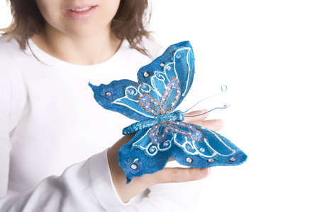 young woman holding blue butterfly Stock Photo