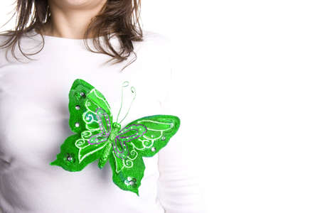 green butterfly standing on young woman chest photo