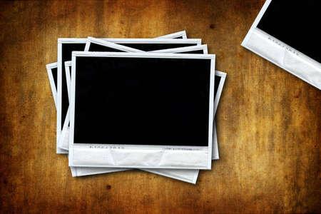 Empty polaroids on grunge background