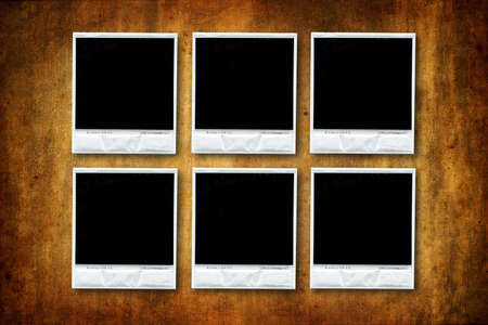 Empty polaroids on grunge background photo
