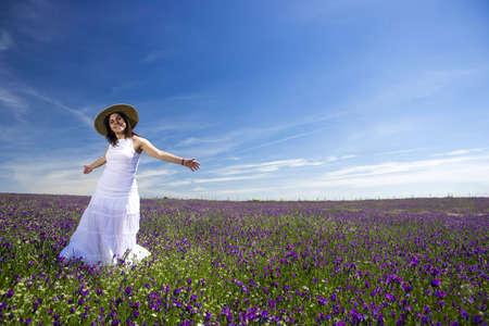 beautiful young woman in white dress enjoying nature