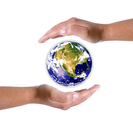 protection concept: hands around earth globe - nature and environment protection concept