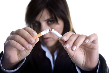 woman breaking cigar - anti-tobacco concept Stock Photo