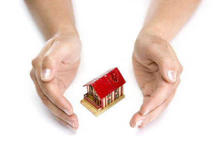 woman hands with small house - real state concept