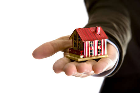 woman hand holding small house - real state concept Stock Photo