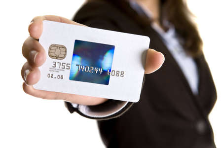 trade credit: businesswoman showing visa credit card - credit card number and date are false