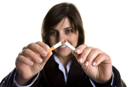 young woman breaking cigar - anti-tobaco concept Stock Photo
