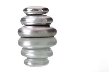 peeble: pile of round peeble stones isolated on white - zen concept
