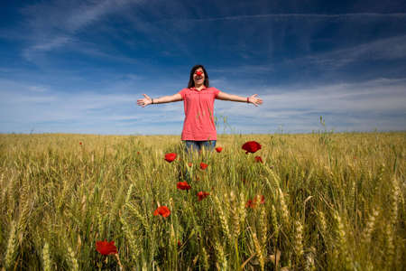 young girl with red clown nose outdoors photo