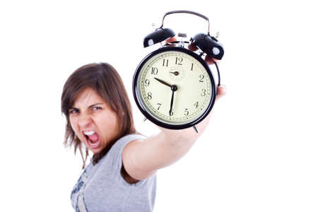 young woman with alarm clock screaming isolated in white background