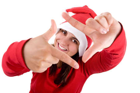 young santa woman in red costume doing a photo frame with her hands isolated on white background photo
