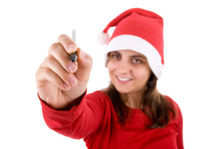 wishlist: young santa woman writing in the screen her present wishlist isolated on white background Stock Photo