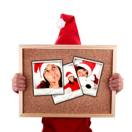 santa woman holding billboard with christmas photos isolated on white background