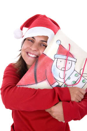 happy young santa woman in red clothing holding present bag in her hands. isolated on white background. photo