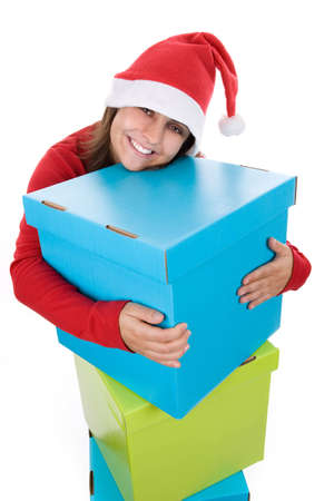 Christmas concept with young santa woman holding giant blue present box isolated on white background photo