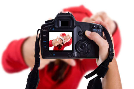 Girl taking photos to a young santa woman in christmas holidays. isolated on white. landscape orientation. Stock Photo