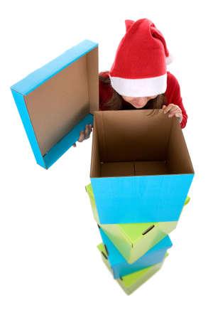 christmas present box: santa woman looking at empty christmas present box isolated on white background Stock Photo