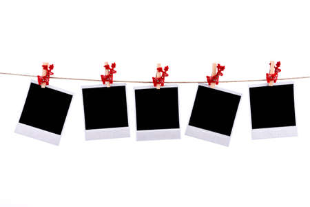 black and white photography: Photos frames with christmas ornaments isolated on white background