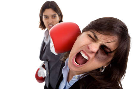 Two businesswoman with boxing gloves fighting. isolated on white background.