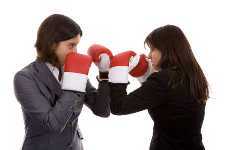 friendly competition: two businesswomen with boxing gloves fighting. isolated on white background.