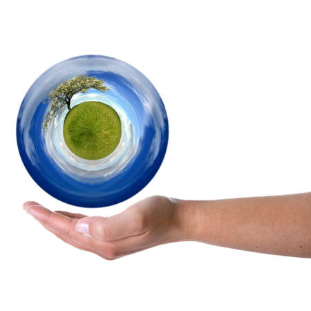 woman hand holding sphere with spring landscape - Environmental concept Stock Photo - 4143594