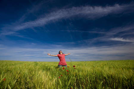beautiful young woman with arms wide open happy in the nature Stock Photo - 4211742