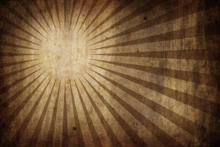 grunge old paper texture background with radial sunburst rays - landscape orientation