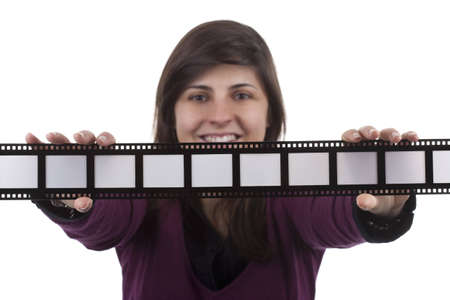 young woman holding film photo frame isolated on white background - you can insert your own text or photos in the frames photo