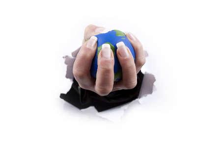 hand holding planet thru a hole isolated on white background Stock Photo - 4440609