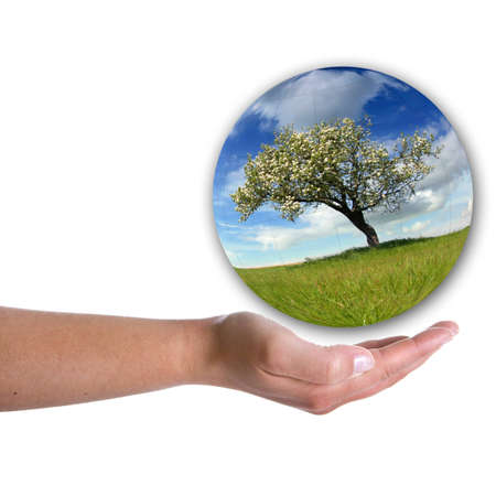 human hand holding landscape inside a bubble isolated on white background photo