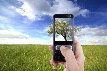 woman taking photo with mobile cell phone - landscape orientation photo