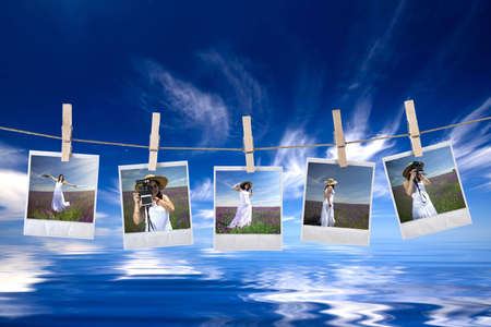 disposable photos frames hanging in the rope on a beautiful summer day - landscape orientation photo