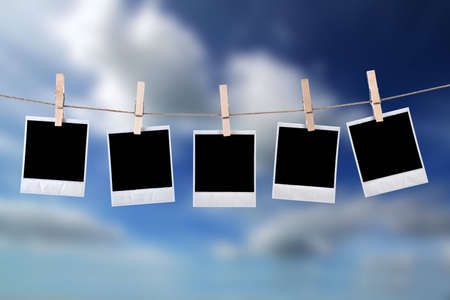 disposable photo frames hanging in the rope with blue sky Stock Photo - 4697856