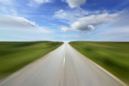 road ahead: Empty road with motion blur - speed and movement concept - landscape orientation